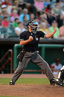 Umpire Joe George makes a call during a game between the Tri-City ValleyCats and Lowell Spinners on July 6, 2013 at Joseph L. Bruno Stadium in Troy, New York.  Lowell defeated Tri-City 4-3.  (Mike Janes/Four Seam Images)