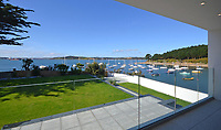 BNPS.co.uk (01202 558833)<br /> Pic: LillicrapChilcott/BNPS<br /> <br /> Water-view...<br /> <br /> A brand new futuristic property perched right on the edge of a sea wall overlooking some of the finest sailing waters in the country has gone up for sale for £4.5m.<br /> <br /> The ultra-modern home and just been built on remote headland in the Cornish sailing village of St Just.<br /> <br /> It replaced a large bungalow that stood on the coastal plot for over 80 years and was demolished by owner and architect Callum Wason.