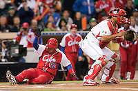 16 March 2009: #12 Michel Enriquez of Cuba slides safely into home plate as he scores against #35 Miguel Ojeda of Mexico during the 2009 World Baseball Classic Pool 1 game 3 at Petco Park in San Diego, California, USA. Cuba wins 7-4 over Mexico.