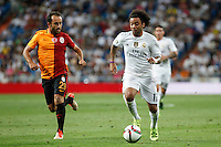 Real Madrid´s Marcelo Vieira (R) and Galatasaray´s Olcan Adin during Santiago Bernabeu Trophy match at Santiago Bernabeu stadium in Madrid, Spain. August 18, 2015. (ALTERPHOTOS/Victor Blanco)