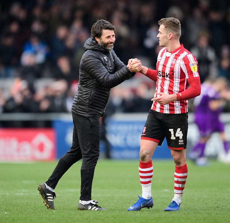 Lincoln City manager Danny Cowley, left, shakes hands with Lincoln City's Harry Toffolo at the end of the game<br /> <br /> Photographer Chris Vaughan/CameraSport<br /> <br /> The EFL Sky Bet League Two - Lincoln City v Grimsby Town - Saturday 19 January 2019 - Sincil Bank - Lincoln<br /> <br /> World Copyright &copy; 2019 CameraSport. All rights reserved. 43 Linden Ave. Countesthorpe. Leicester. England. LE8 5PG - Tel: +44 (0) 116 277 4147 - admin@camerasport.com - www.camerasport.com