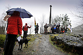 Glencoe Massacre commemoration - drookit onlookers and marchers gather at the Memorial - picture by Donald MacLeod -13.02.13 - 07702 319 738 - clanmacleod@btinternet.com - www.donald-macleod.com
