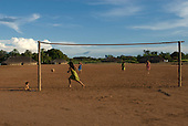 Xingu Indigenous Park, Mato Grosso State, Brazil. Aldeia Matipu; girls and women playing football.