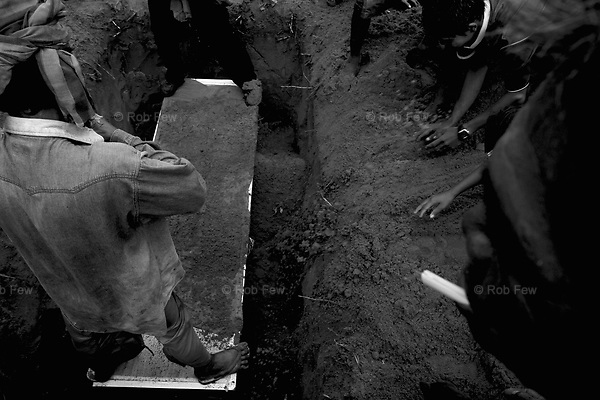 Mool's brother stands on the coffin while mourners throw the first earth into the grave. Everyone takes part in the actual burial.<br /> <br /> On April 27, Mrs Mool Klatalay was savagely beaten by her drunken husband. The beating took place in the hovel where Mool lived in a small sea gypsy village in southern Thailand's Phang Nga province. Villagers heard her screams, but no one intervened. No one took her to hospital. She died at home 48 hours later, after losing four pints of blood through internal bleeding. She leaves two sons, aged 19 and 12, and a daughter, aged 3.