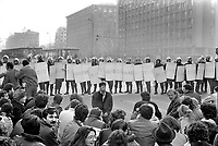 ROMANIA, Bd. Magheru, Bucharest, 21.12.1989<br /> People rise against Ceausescu. A commissioned pro-regime rally turns into a protest demonstration. People block the Magheru Boulevard. To show that they are peaceful they offer flowers to the policemen. Nevertheless armoured army vehicles are later driven into the crowd.<br /> © Andrei Pandele / EST&OST