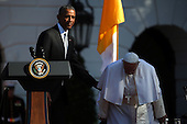 (L-R) U.S. President Barack Obama guides Pope Francis to his chair during his arrival ceremony at the White House on September 23, 2015 in Washington, DC. The Pope begins his first trip to the United States at the White House followed by a visit to St. Matthew's Cathedral, and will then hold a Mass on the grounds of the Basilica of the National Shrine of the Immaculate Conception. <br /> Credit: Win McNamee / Pool via CNP
