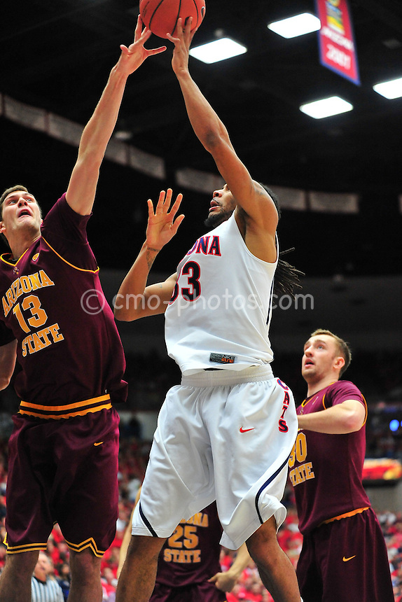 Jan 15, 2011; Tucson, AZ, USA; Arizona Wildcats forward Jesse Perry (33) has his shot blocked by Arizona State Sun Devils center Jordan Bachynski (13) in the 2nd half of a game at the McKale Center.  The Wildcats won the game 80-69.