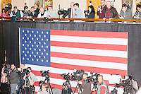 Media look on as Republican presidential candidate and New Jersey governor Chris Christie speaks at his final New Hampshire town hall of the primary election at the St. George Greek Orthodox Cathedral in Manchester, New Hampshire, on Mon., Feb., 8, 2016.