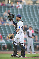 Northwest Arkansas Naturals catcher Meibrys Viloria (22) walks back to the plate during a Texas League game between the Northwest Arkansas Naturals and the Arkansas Travelers on May 30, 2019 at Arvest Ballpark in Springdale, Arkansas. (Jason Ivester/Four Seam Images)