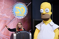 """New York - DECEMBER 17: Nancy Cartwright speaks to the media as he participates in the ceremonial lighting of the Empire State Building as they attend the Empire State Building Celebration of the 30th Anniversary of FOX's """"The Simpsons"""" on December 17, 2018 in New York City.  (Photo by Anthony Behar/FOX/PictureGroup)"""