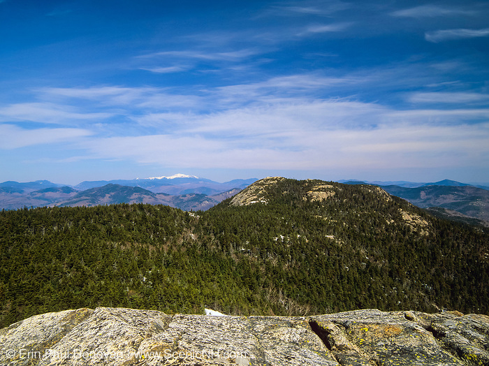 Scenic views of Three Sisters from Mount Chocorua with the Mount Washington in the back ground snow capped, which is in the White Mountains, New Hampshire USA