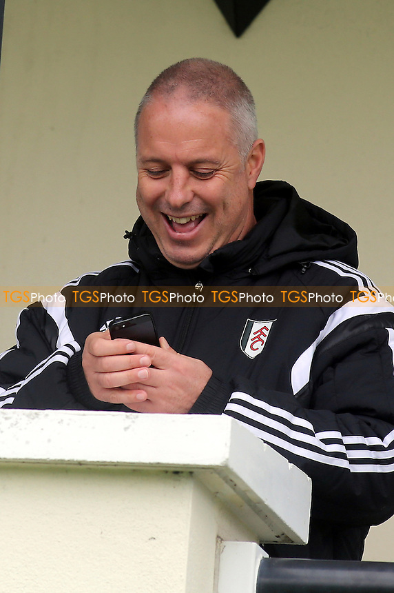 Fulham caretaker manager, Kit Symons, receives a text - Fulham Under-21 vs Liverpool Under-21 - Barclays Under-21 Premier League Football at Motspur Park Training Ground, Surrey - 26/10/14 - MANDATORY CREDIT: Paul Dennis/TGSPHOTO - Self billing applies where appropriate - contact@tgsphoto.co.uk - NO UNPAID USE