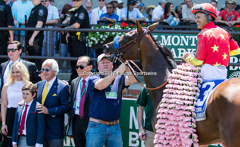 ELMONT, NY - JUNE 10: (L-R) Jill Baffert, Bode Baffert, trainer Bob Baffert, and co-owner Teo Ah Khing pose for a photograph in the winner's circle with Mike Smith, aboard Abel Tasman #3, after winning on Belmont Stakes Day at Belmont Park on June 10, 2017 in Elmont, New York (Photo by Sue Kawczynski/Eclipse Sportswire/Getty Images)