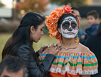NWA Democrat-Gazette/BEN GOFF @NWABENGOFF<br /> Elia Davis (left) of Fayetteville helps Selina Hernandez, a dancer with Latin Art Organization of Northwest Arkansas, of Springdale with her makeup Friday, Nov. 2, 2018, before a Dia de los Muertos procession from Shiloh Square to the Arts Center of the Ozarks in downtown Springdale.
