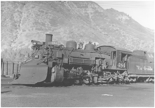 3/4 fireman side view of K-36 #484 with plow at Durango.<br /> D&amp;RGW  Durango, CO