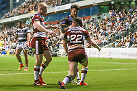 Picture by David Neilson/SWpix.com/PhotosportNZ - 10/02/2018 - Rugby League - Betfred Super League - Wigan Warriors v Hull FC  - WIN Stadium, Wollongong, Australia - Wigan's Liam Marshall is congratulated on scoring his second try against Hull FC.