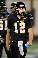 1 September 2011:  FIU quarterback Jake Medlock (12) looks for a signal from the bench late in the game as the FIU Golden Panthers defeated the University of North Texas, 41-16, at FIU Stadium in Miami, Florida.
