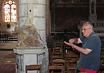 VMI Vincentian Heritage Tour: The Rev. Edward Udovic, C.M., describes one of the statues found in L'église Saint-André as members of the VMI visit Joigny France Thursday, June 30, 2016. (DePaul University/Jamie Moncrief)
