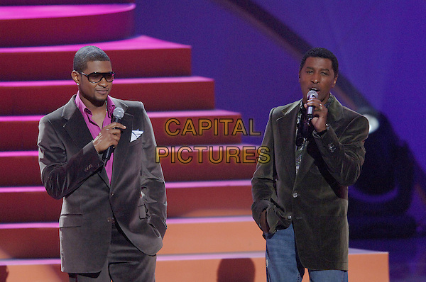 USHER & BABYFACE.Performs at The World Music Awards-Show held at the Kodak Theatre,.Hollywood, 31st  August 2005.half length stage gig concert pink shirt velvet suit sunglasses microphone.www.capitalpictures.com.sales@capitalpictures.com.© Capital Pictures.