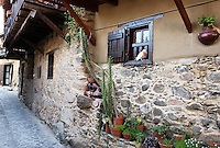 Stock photo: A narrow alley in Kakopetria Cyprus with old fashioned stone house decorated with planters.
