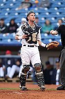 Lake County Captains catcher Richard Stock (28) watches a foul ball while getting a new one from the umpire during a game against the Dayton Dragons on June 8, 2014 at Classic Park in Eastlake, Ohio.  Lake County defeated Dayton 4-2.  (Mike Janes/Four Seam Images)