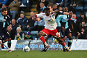Don Cowan of Stevenage escapes from Dave Winfield of Wycombe. - Wycombe Wanderers v Stevenage - Adams Park, High Wycombe - 31st December 2011  .© Kevin Coleman 2011