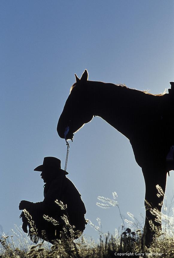 Cowboy and horse in silhouette. Ponderosa Ranch. Senaca OR.