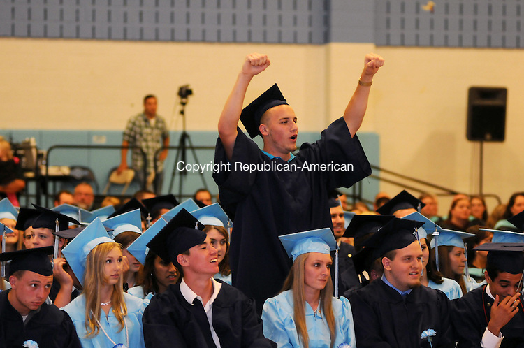 OXFORD, CT, 19 JUN 12-061912AJ31-  Matt Moran cheers on his friends as they receive diplomas at Oxford High School's commencement on Tuesday. Alec Johnson/ Republican-American