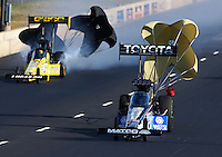 Jul. 20, 2013; Morrison, CO, USA: NHRA top fuel dragster driver Antron Brown (right) races alongside Morgan Lucas during qualifying for the Mile High Nationals at Bandimere Speedway. Mandatory Credit: Mark J. Rebilas-