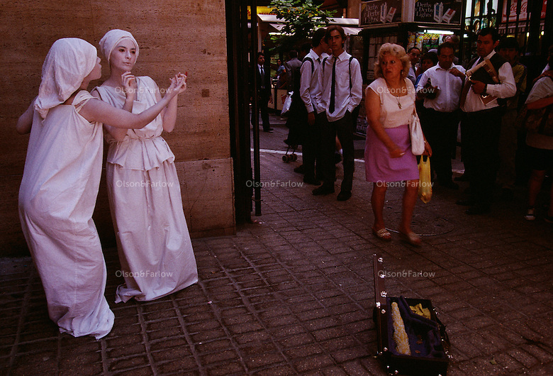 Living Tableaux attracts lunch time crowds as people watch the street theater performance in downtown Santiago.