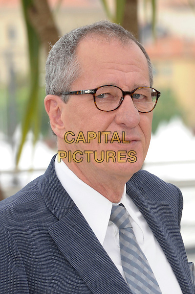 GEOFFREY RUSH.'Pirates of the Caribbean: On Stranger Tides' photocall at the Palais de Festival, 64th International Cannes Film Festival, France.14th May 2011.portrait headshot glasses grey gray suit tie white shirt .CAP/PL.©Phil Loftus/Capital Pictures.