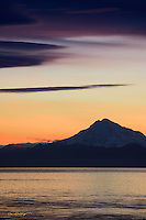 The setting sun paints Mount Redoubt vividly as night awaits south central Alaska.