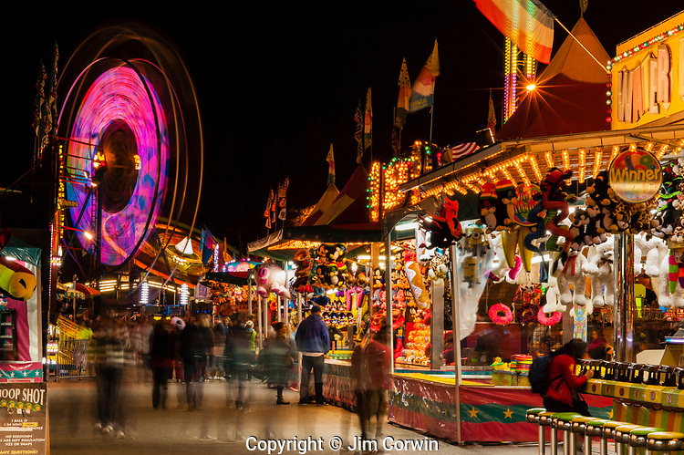 Evergreen State Fair at twilight with game booths at night Monroe Washington State USA