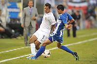 Celso Borges (5) of Costa RIca goes against Edder Delgado (23) of Honduras.  Honduras defeated Costa Rica 1-0 at the quaterfinal game of the Concacaf Gold Cup, M&T Stadium, Sunday July 21 , 2013.