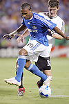 Oct 05 2007:  Scott Sealy (19) of the Wizards moves the ball past Bobby Boswell (behind) of D.C. United.  The MLS Kansas City Wizards tied the visiting D.C.United 1-1 at Arrowhead Stadium in Kansas City, Missouri, in a regular season league soccer match.