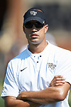 Wake Forest Demon Deacons cornerbacks coach Ryan Crawford watches the team warm-up prior to the game against the Notre Dame Fighting Irish at BB&T Field on September 22, 2018 in Winston-Salem, North Carolina. The Fighting Irish defeated the Demon Deacons 56-27. (Brian Westerholt/Sports On Film)