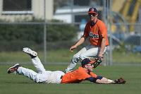 Gettysburg Bullets outfielder Patrick O'Grady (18) makes a diving catch as Al Posch (16) backs up the play during the first game of a doubleheader against the Edgewood Eagles at the Lee County Player Development Complex on March 10, 2014 in Fort Myers, Florida.  Gettysburg defeated Edgewood 3-2.  (Mike Janes/Four Seam Images)