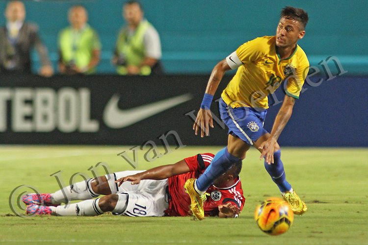 Neymar da Silva Santos Júnior back on the pitch in September 5th 2014 friendly match vs Columbia. Columbia's Camilo Zúñiga lies on the pitch.