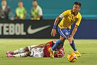 Neymar da Silva Santos Júnior back on the pitch in September 5th 2014 friendly match vs Columbia. Columbia's Camilo Zúñiga lies on the pitch.
