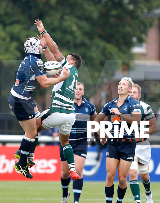 Ealing's Curtis Wilson is beaten to the catch by Bedford's Benjamin Adams during the Greene King IPA Championship match between Ealing Trailfinders and Bedford Blues at Castle Bar , West Ealing , England  on 29 October 2016. Photo by Carlton Myrie / PRiME Media
