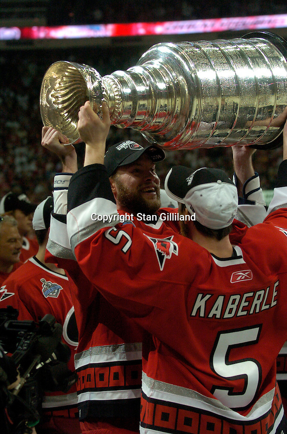 Frantisek Kaberle (5) passes the Stanley Cup to Josef Vasicek after the Carolina Hurricanes beat the Edmonton Oilers 3-1 in game seven to win the series at the RBC Center in Raleigh, NC Monday, June 19, 2006. Both are from the Czech Republic.