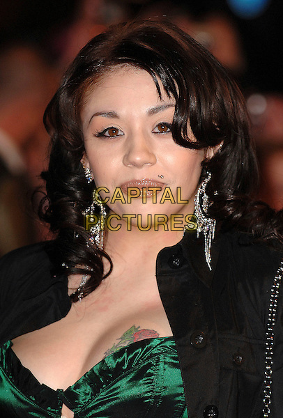 MUTYA BUENA.attending the 2007 Brit Awards, Earls Court, .London, England,14th February 2007..Brits portrait headshot green corset top tattoo cleavage breast boob.CAP/ BEL.©Tom Belcher/Capital Pictures.