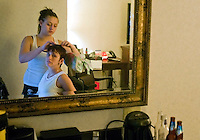 Kara gets help with her hair before possible love interest arrives at her birthday party in a Syracuse hotel room.