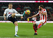 9th December 2017, Wembley Stadium, London England; EPL Premier League football, Tottenham Hotspur versus Stoke City; Kieran Trippier of Tottenham Hotspur crossing the ball over Erik Pieters of Stoke City