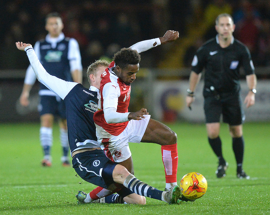 Fleetwood Town's Tariqe Fosu is tackled<br /> <br /> Photographer Dave Howarth/CameraSport<br /> <br /> Football - The Football League Sky Bet League One - Fleetwood Town v Millwall - Tuesday 24th November 2015 - Highbury Stadium<br /> <br /> &copy; CameraSport - 43 Linden Ave. Countesthorpe. Leicester. England. LE8 5PG - Tel: +44 (0) 116 277 4147 - admin@camerasport.com - www.camerasport.com