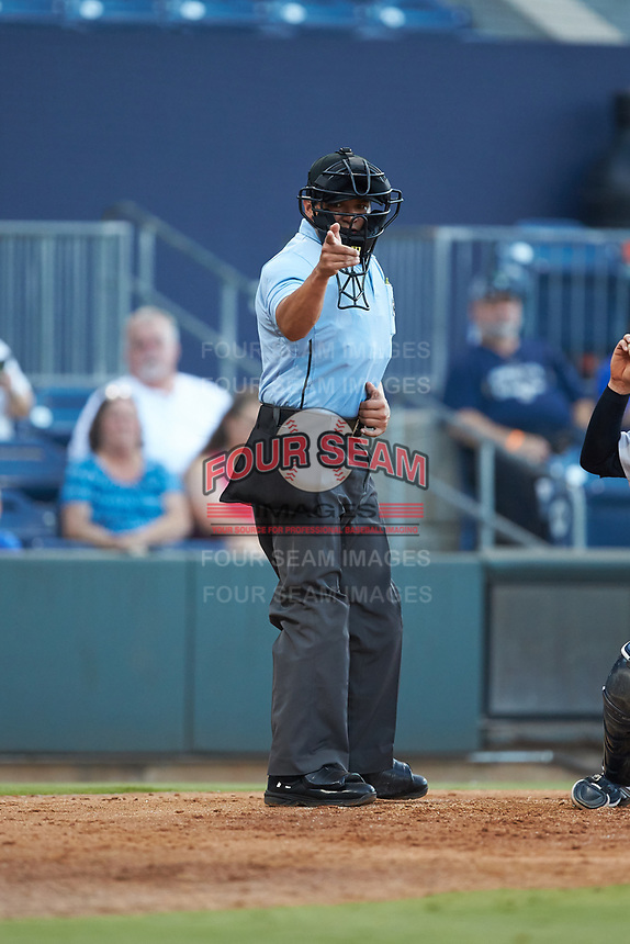Home plate umpire Charlie Ramos makes a strike call during the International League game between the Scranton/Wilkes-Barre RailRiders and the Gwinnett Stripers at BB&T BallPark on August 16, 2019 in Lawrenceville, Georgia. The Stripers defeated the RailRiders 5-2. (Brian Westerholt/Four Seam Images)