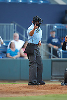 Home plate umpire Charlie Ramos makes a strike call during the International League game between the Scranton/Wilkes-Barre RailRiders and the Gwinnett Stripers at Coolray Field on August 16, 2019 in Lawrenceville, Georgia. The Stripers defeated the RailRiders 5-2. (Brian Westerholt/Four Seam Images)