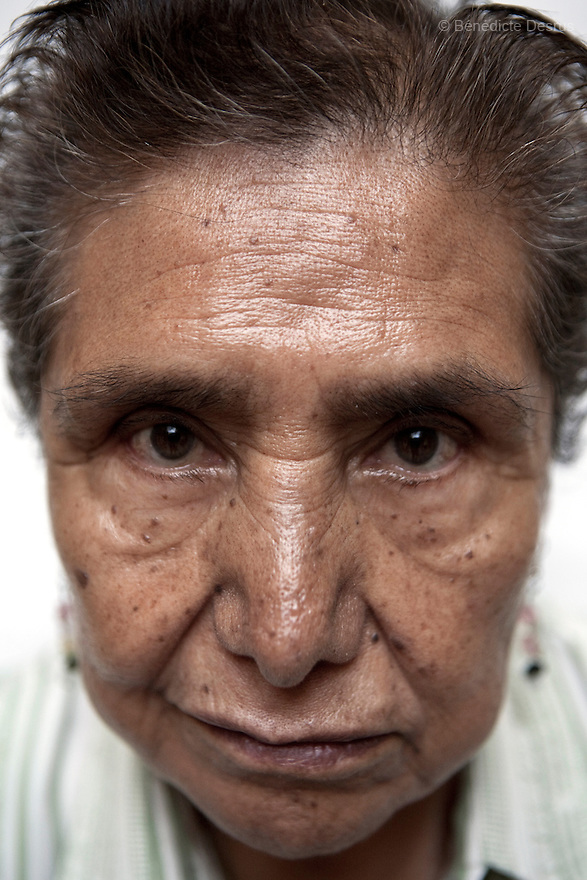 Portrait of Normita, a resident of Casa Xochiquetzal, at the shelter in Mexico City on July 28, 2008. Casa Xochiquetzal is a shelter for elderly sex workers in Mexico City. It gives the women refuge, food, health services, a space to learn about their human rights and courses to help them rediscover their self-confidence and deal with traumatic aspects of their lives. Casa Xochiquetzal provides a space to age with dignity for a group of vulnerable women who are often invisible to society at large. It is the only such shelter existing in Latin America. Photo by Bénédicte Desrus