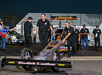 Nov 9, 2018; Pomona, CA, USA; Crew members for NHRA top fuel driver Mike Salinas during qualifying for the Auto Club Finals at Auto Club Raceway. Mandatory Credit: Mark J. Rebilas-USA TODAY Sports