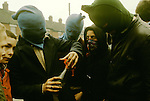 Ireland The Troubles. Belfast 1980s. Teenage Catholic youths make petrol bombs.